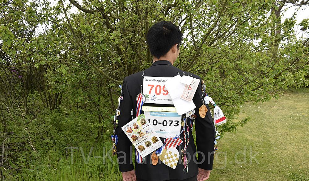 Den velkendte Rotary Klub jakke med alle badgene på. Foto: Gitte Korsgaard.
